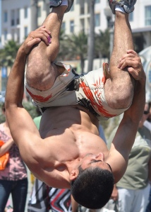 street performer upside down in a mid-air somersault