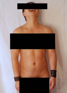Nude male model with black censoring bars