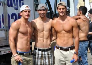 three muscular young men posing