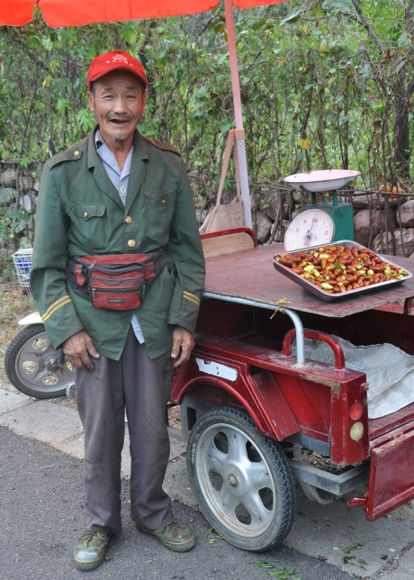 Fig seller wearing People's Army uniform