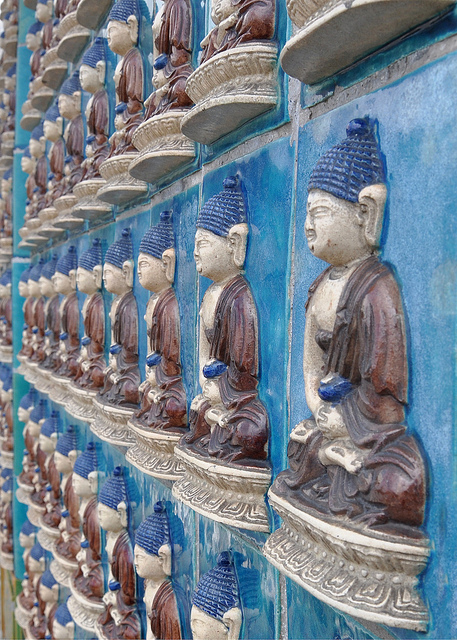 Glazed clay Buddhas lining a wall of the White Dagoba, Beihai Park, Beijing
