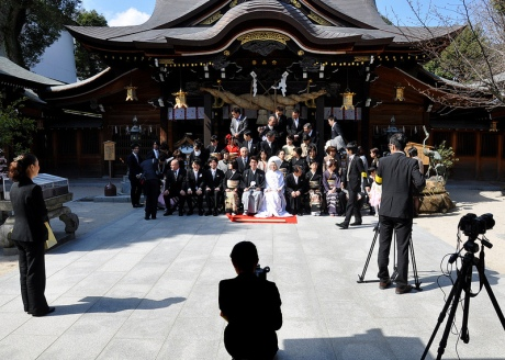 Setting up for a wedding photograph at Kushida Shrine in Fukuoka, Japan