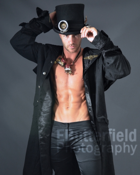 Muscular shirtless male model in steampunk costume