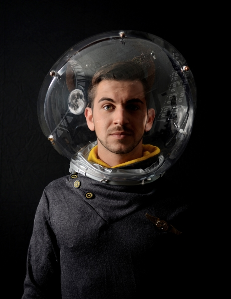 A young man aboard (or apparently not quite aboard, if we are to believe his headgear) the Royal Albert Orbital Platform. As a member of the Near-Earth Manned Orbital programme, he is referred to as a
